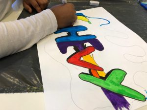 Gekleurde tekening met de tekst Hevy